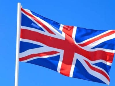 Union jack flag against a blue sky, UK.