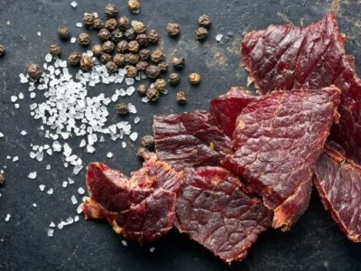 beef jerky and spice on old table