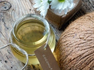 Coconut oil, essential oil from nature, a skin care that safe, rich vintamin, use in massage at spa, organic cosmetic on wooden background
