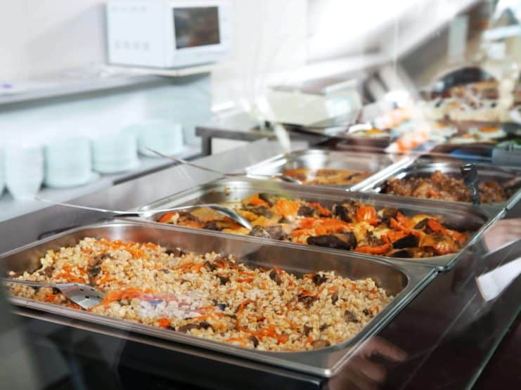 Containers with healthy food in school canteen