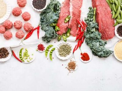 Variety raw beef cuts, meatbals and vegetables on table copy space overhead of cooking ingredients